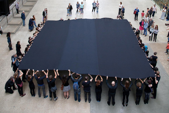 Performers unveiling Liberate Tate's Black Square